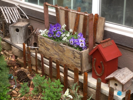 Farrier's toolbox into planter and a file edging
