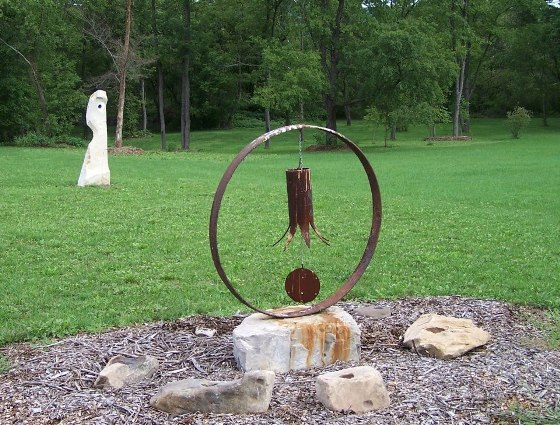 """George Weaver massive 'music' maker.  He says, """"Wind chime made from a steel pipe and a wood clacker.."""""""