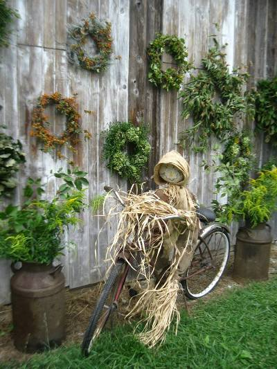 Add a scarecrow to an old bike...The Little Shop Antiques bike and wreaths