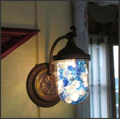 Nancy Carter ‎sparkled up her porch light with glass gems