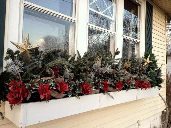 Debbie Wettergren's simple window boxes with greenery and pointsettias...