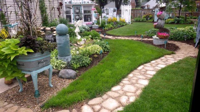 A look along Ann Elias's garden path winding through the garden