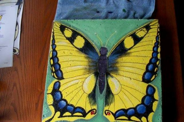 Sue Gerdes paints her stepping stones with craft paint