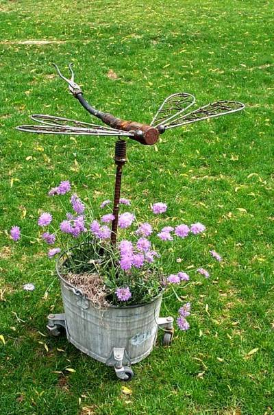 Wenda Vorce welded a dragon fly in a mop bucket