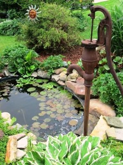 Displaying antique pumps in your garden flea market for Pump water from pond to garden