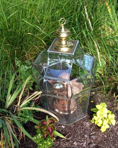 Ann's same cloche with a garden statue under it