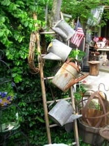 Laura Goines found a cute way to hang her watering cans