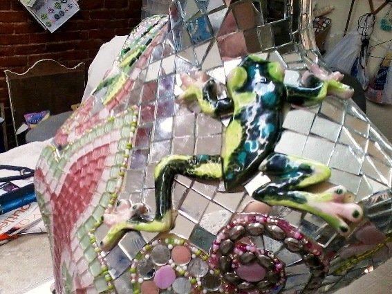 A whimsical frog 'signature' is included in many of Becky's mosaics
