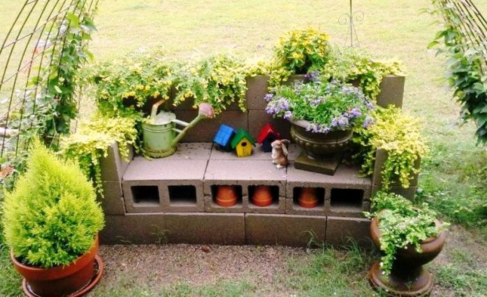 Tiny birdhouses accent the summer bloom