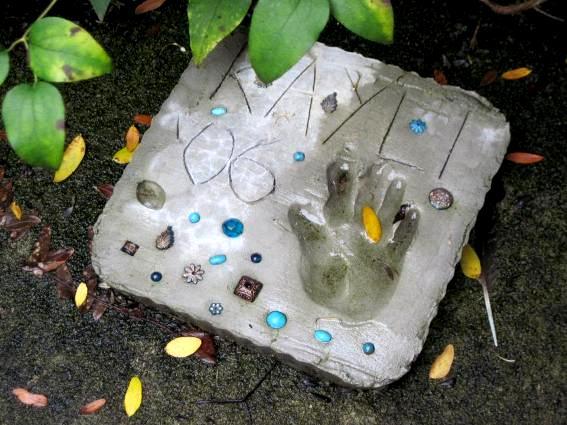 Jeanie Merritt made a hand print stepping stone