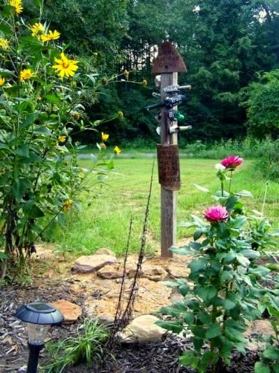 Sue Jordan 's sign pole welcomes her grandkids to her garden