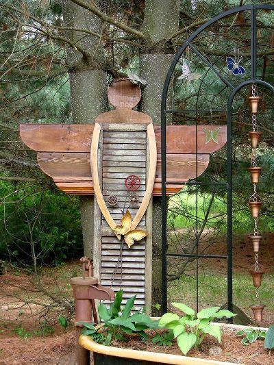 The angel, set in her place,...in Jeanne's secret garden