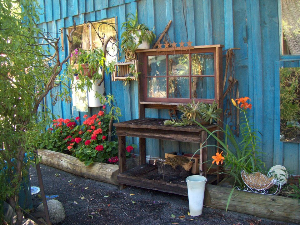 Julie Scherbarth shows us the potter's bench her husband built and set against the colorful wall of their shed.
