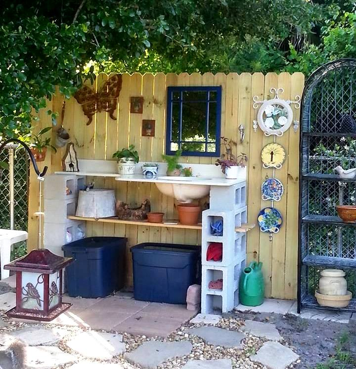 """June Chalakee says, """"Hubby made this potting bench for me. I found the ceramic vanity sink at a junk store and from there the ideas just took off."""""""