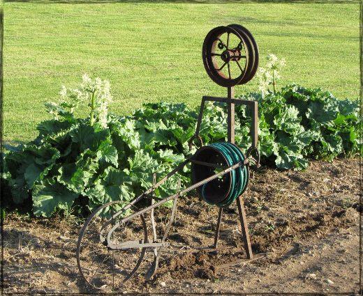 George Weaver's machinery man uses wheels and hose reels