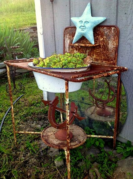 Kathy Engel's rusty treasure let's the plants shine