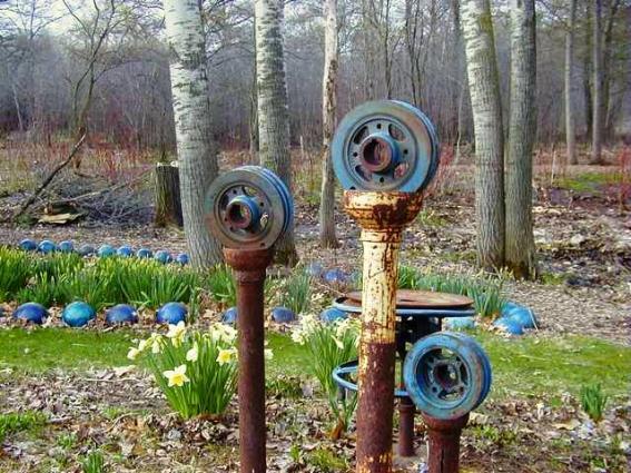 Lark Kulikowski's blue tinged cart parts on rusty pipes