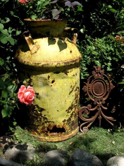 Peggy Blanton's milk can os painted but the rust shines through