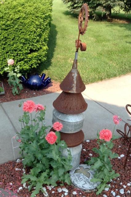 Poppies and Nancy K. Meyer's funnel tree by back door!