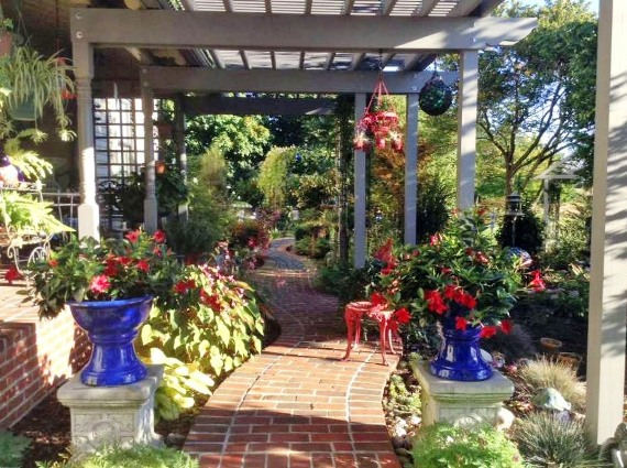 A winding brick path leads you into the garden