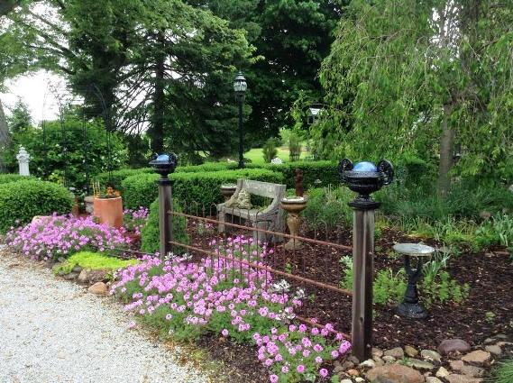 An elegant pocket garden with pink verbena