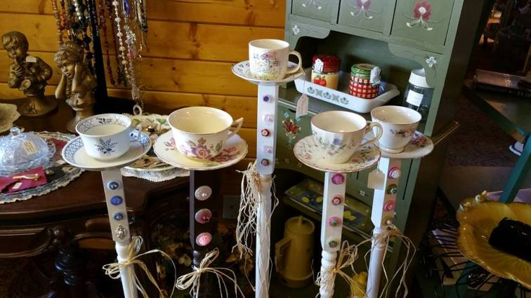 Tea time bird feeders on wooden spindles