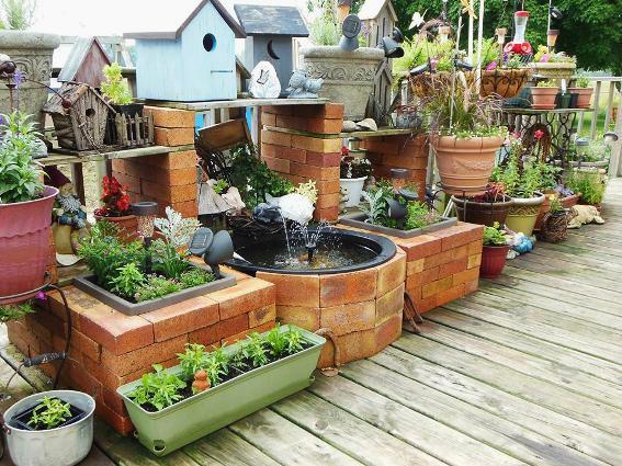 Deck garden using old bricks from our sidewalk
