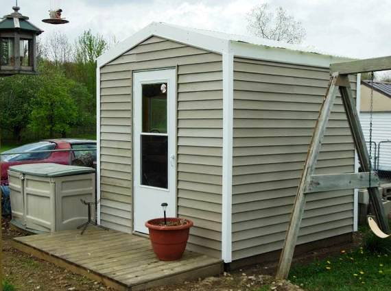 Kathie's new shed, not as rustic as she wanted, but matching the house