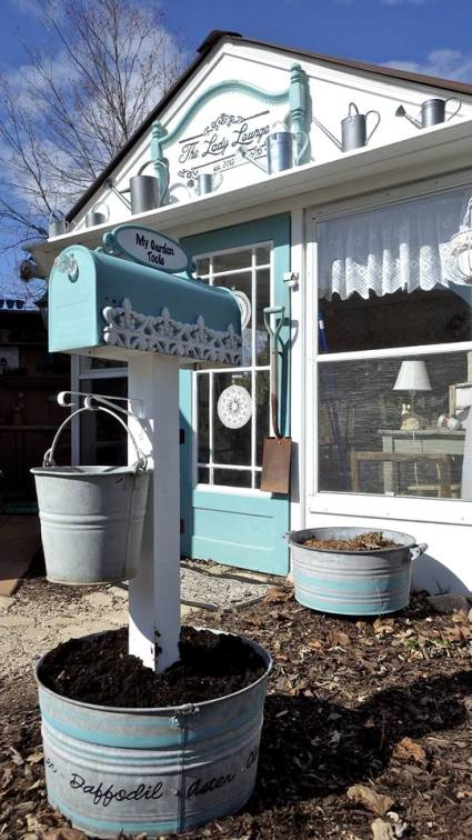 A tub makes a good base for a 'garden tool' mailbox