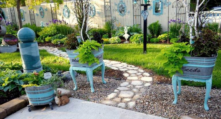 Ann's garden path and her 'Welcome' tub planters