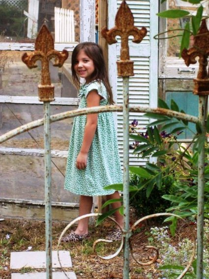 Kathy Gilbert granddaughter and the garden gate leading to the cottage style garden
