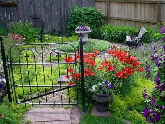 Sandy Faust's gate is practical and leads to a circle garden