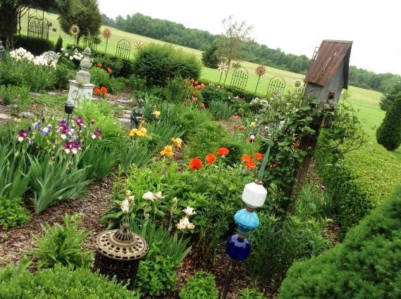 Constance's vertical trellises and garden art are the garden's gems