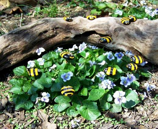 Sue Jordan and her grandkids, painted smooth stones to 'bee' bees!