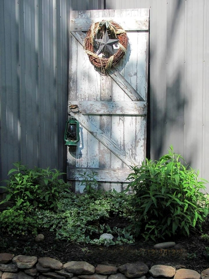 Sherri Calvert's second door in a shady garden corner