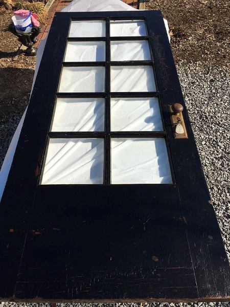 Natalie repurposed this old glass paned front door