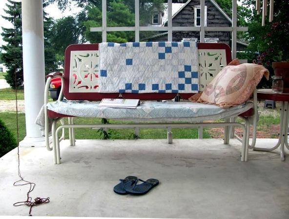 Tina Root's perfect napping spot with Flea Market quilt coziness