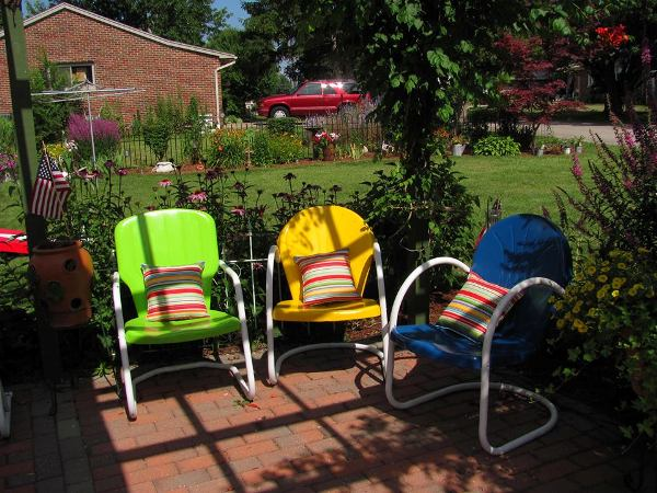 Tina Root's pimary colored chairs for the front garden
