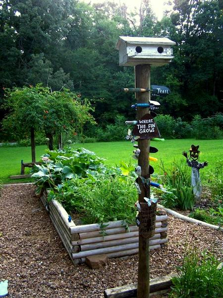 'Where the Fun Grows!' Added a birdhouse to the top of our signpost....
