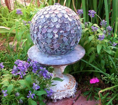 Love the patina on this penny ball, Bowling ball covered with pennies, What a great patina it has achieved in the garden.