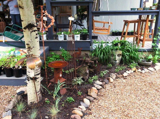 Rock lined garden beds create islands to plant in....a good design for any garden