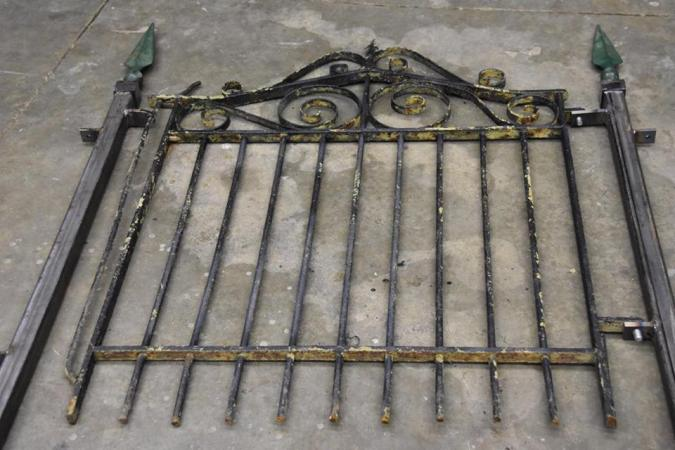The old vintage gate is still wearing some of its old paint