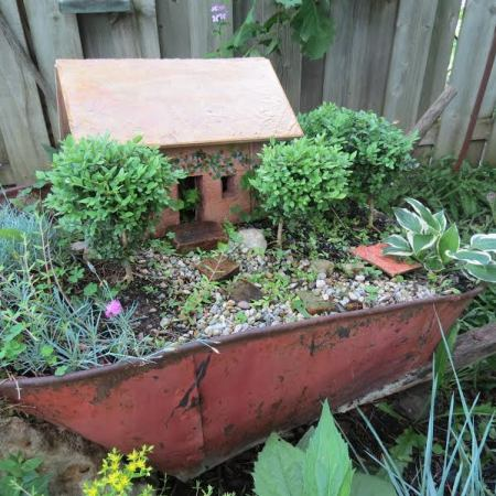A fairy garden gives new life to a re-purposed vintage wheelbarrow