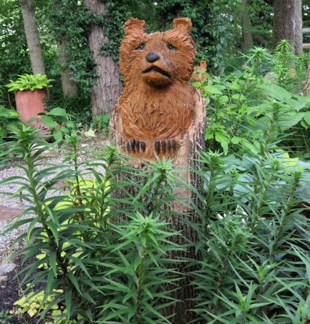 A friend of Dick's who is a wood carver designed this bear for his gardens.. Does a bear 'go' in the woods